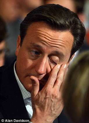David Cameron rubs his eyes as he listens to William Hague's speech