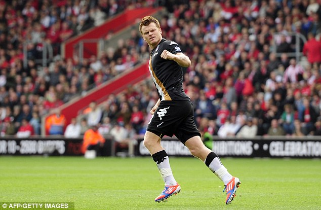 Delight: John Arne Riise celebrates after his shot is turned into his own net by Jos Hooiveld