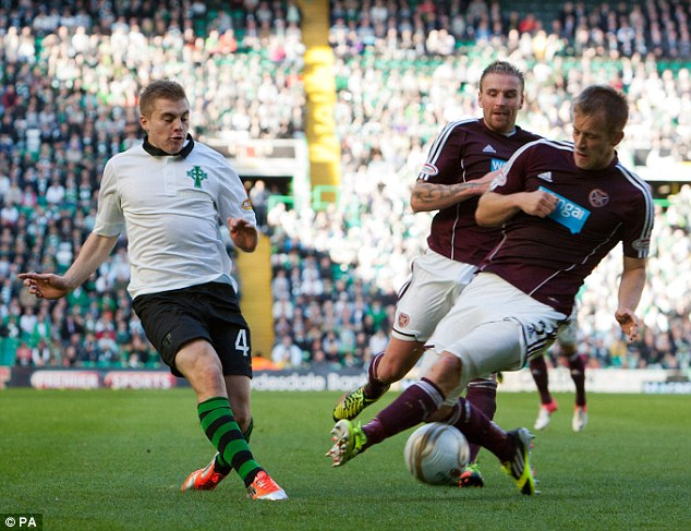 In the thick of it: James Forrest cross is blocked by Danny Grainger (right)