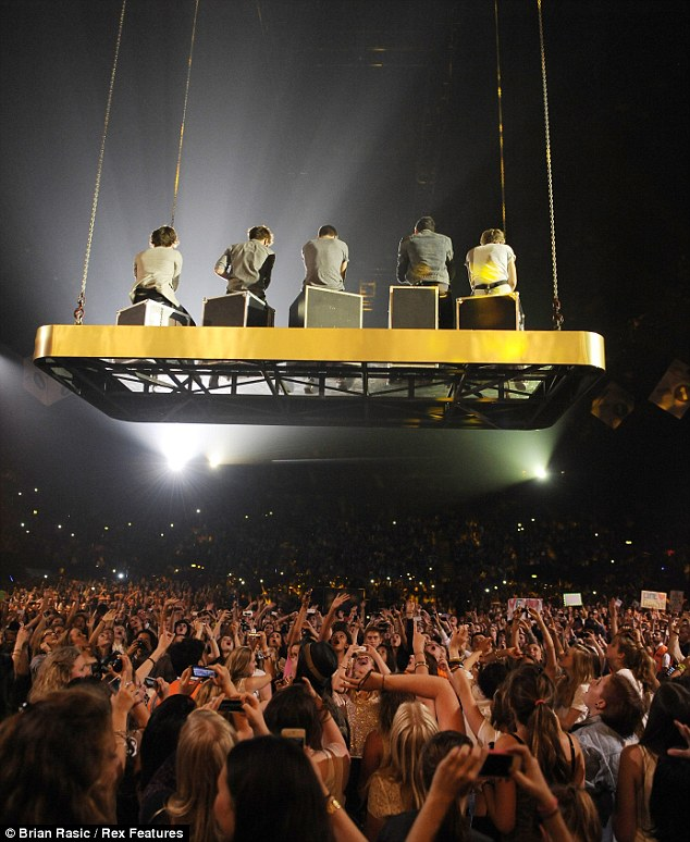 So close! They sent the fans wild as they performed on a floating plinth above their heads during the extravaganza