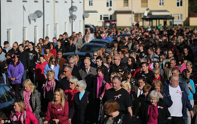 Sadness: Hundreds of people turned out to pay their respects today as an emotional service took place for missing April. They walked through the Welsh town of Machynlleth, as normal life came to a standstill