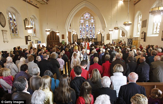 Service: Members of the community of Machynlleth attend St Peter's Church for a time of reflection on April