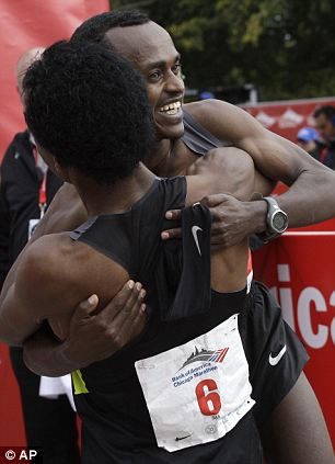Tsegaye Kebede back, celebrates with fellow Ethiopian Feyisa Lilesa (6), after Kebede won first place and Lilesa finished second