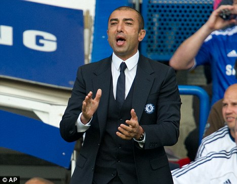 Laying down the law: Di Matteo has stern words for the Chelsea players