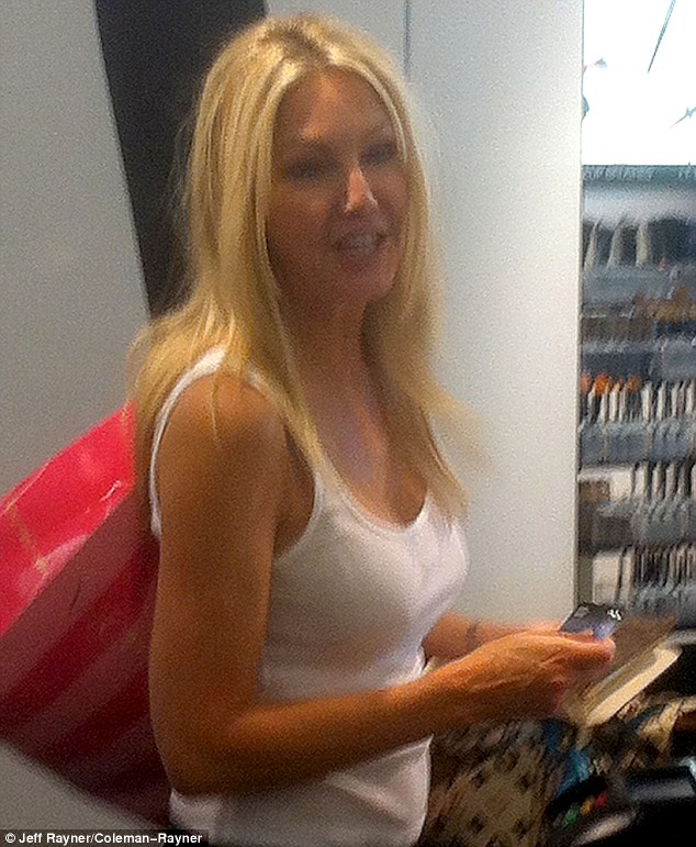 Smiling star: Heather appeared jovial during the outing during which she also shopped up a storm at Victoria's Secret