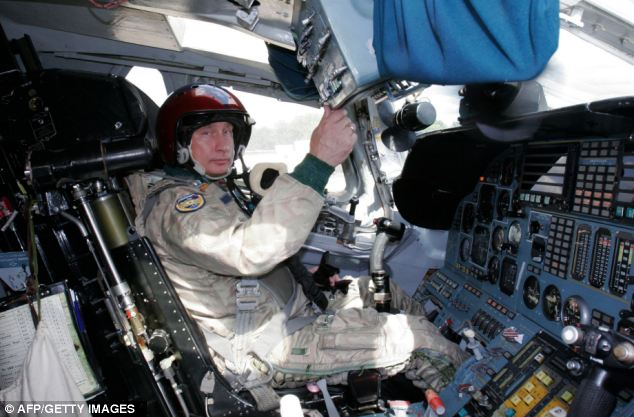 Multitasking: Vladimir Putin in the cockpit of Tupolev Tu-160 strategic bomber jet at a military airport, outside Moscow, before his supersonic flight in the cruise-missile carrying bomber jet