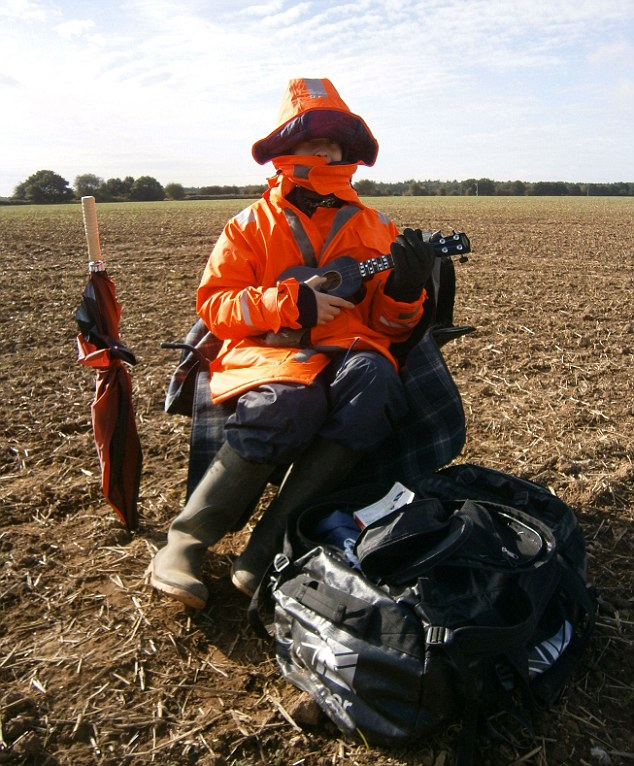 Field of dreams: University graduate Jamie Fox is working as a human scarecrow to save up for a trip to New Zealand