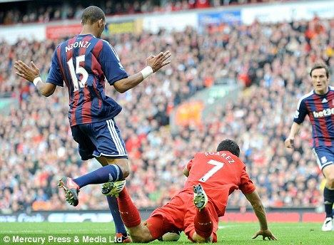 Decked: Suarez, though, has been widely criticised for taking a dive in the same game