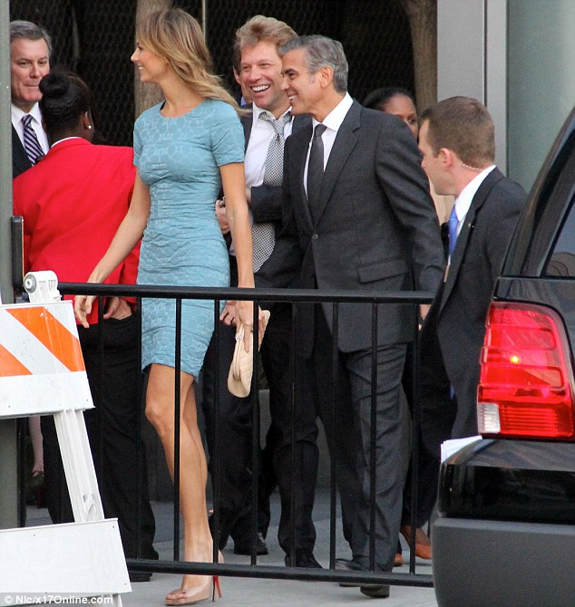 Sharing a joke: The couple walked in with Jon Bon Jovi, and all three enjoyed a laugh