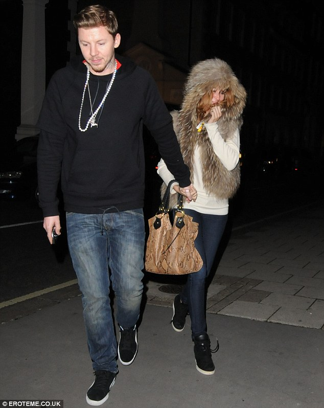 The couple that dress together... Professor Green and Millie Mackintosh sported matching trainers on a date night in London on Sunday evening