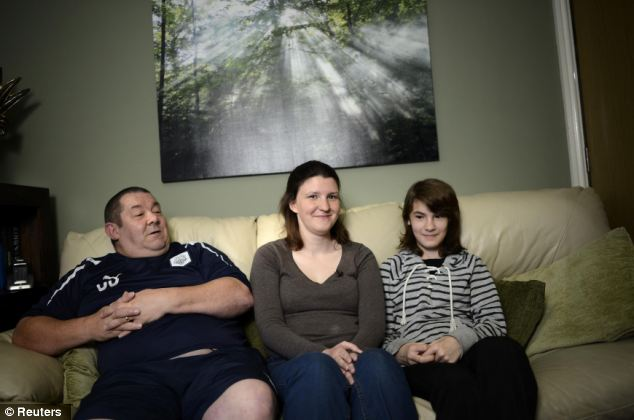 Cuppa and a catch-up, Mitt? Simon Nash, his wife Maria and their 12-year-old daughter Sarah at their home in Preston, northern England. Mrs Nash is Romney's fourth cousin, twice removed