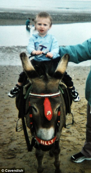 Liam on a less jet-setting holiday: As a toddler riding on a donkey in Blackpool