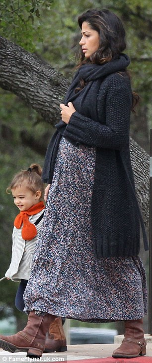 Fashionable family: Camila finished off her outfit with a black cardigan and a pair of brown cowboy-style boots