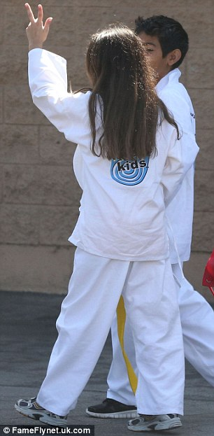 All-white: Long-haired Blanket got kitted out in his martial arts gear