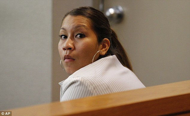 Child abuse: Elizabeth Escalona, 23, sits in a courtroom waiting to be sentenced today in Dallas