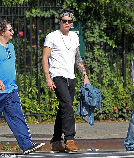 Casual style: John was seen out with friends on Friday for a spot of lunch