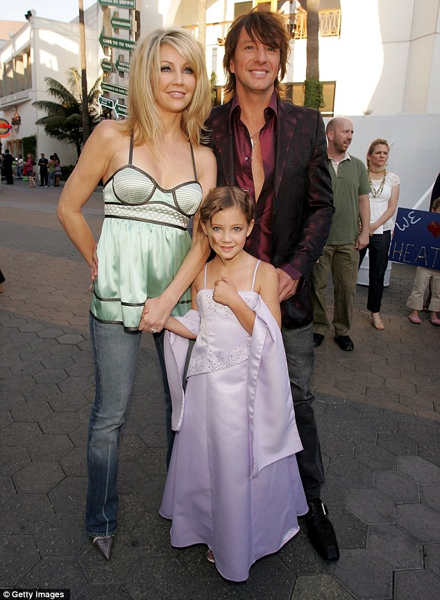 Happy family: Heather, Richie and Ava are pictured in June 2005, when the couple were still married