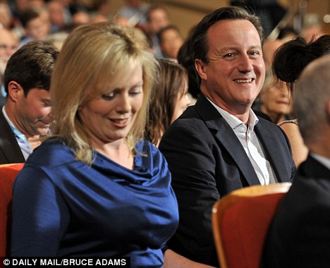 Ffabulous Ffion: David Cameron sits next to the Foreign Secretary's wife during his speech