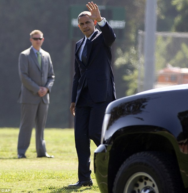 Hello, California! President Barack Obama waves after arriving in LA today