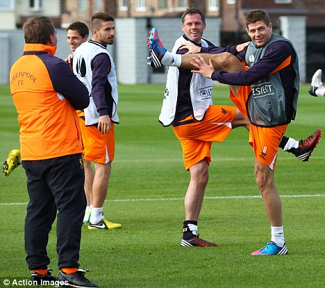 All smiles: Rodgers oversees Liverpool training last week