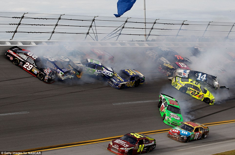 Carnage: The racers collided amid screeching tyres and clouds of smoke