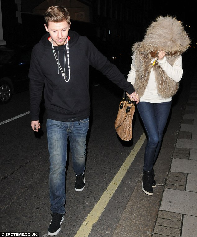 Why so shy? Millie attempted to keep her head down as she and the rapper headed home from their night out