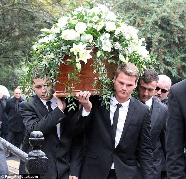 Pallbearers, believed to be Charlie's grandsons, carry the coffin into the church in New Camberwell