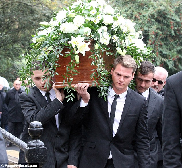 Mourning: Pallbearers take Richardson's coffin in to the South London church for the start of his funeral ceremony