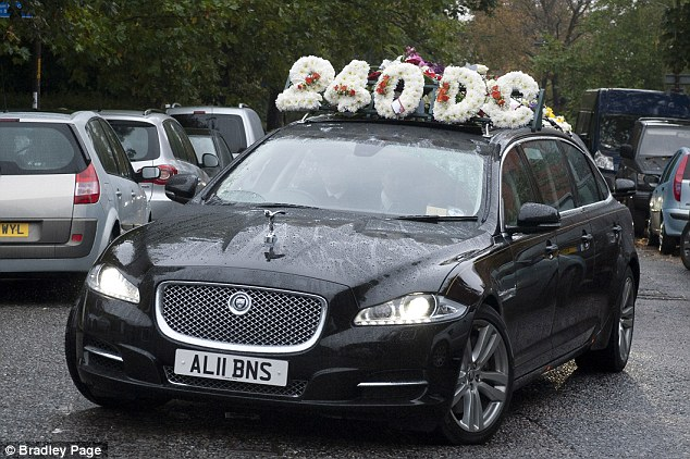 Torture reference: The funeral cortege arrives at Honor Oak Crematorium in south London today