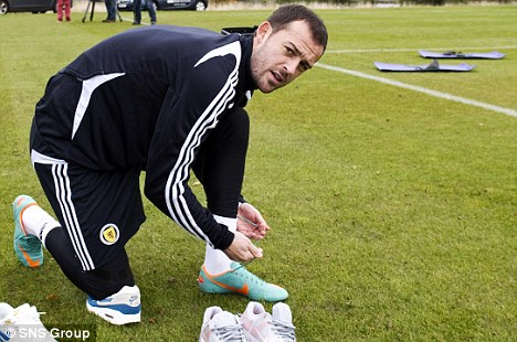 These boots were made for talking: Fletcher at Scotland training on Monday