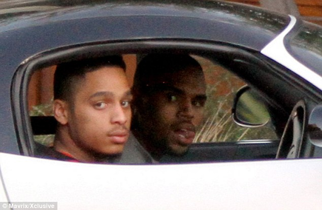 Out and about: Chris Brown was meanwhile spotted driving around in the Hollywood Hills with a friend earlier on Sunday