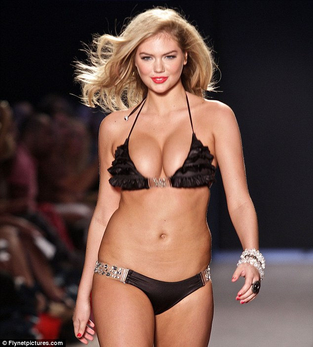 Used to baring her body: Kate walking the runway during the Beach Bunny Swimwear show during Mercedes-Benz Fashion Week Swim 2012