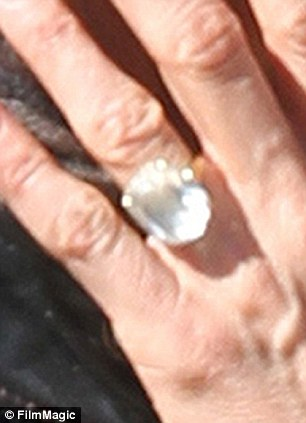 Finally flaunting it: She showed off her huge diamond as she caressed he fiance's face
