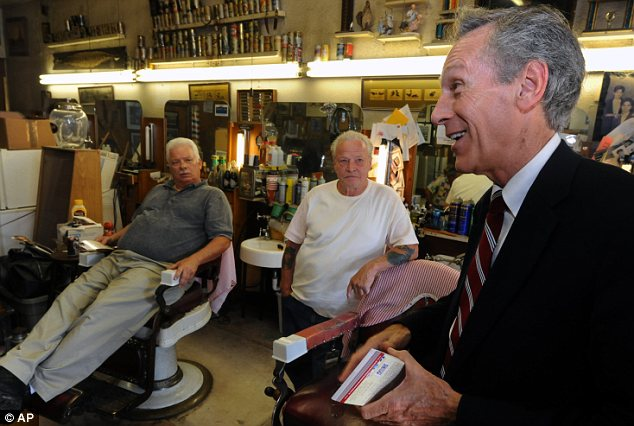 Campaign trail: Mr Goode, pictured in a Lynchburg barber shop, is a familiar face in much of Virginia