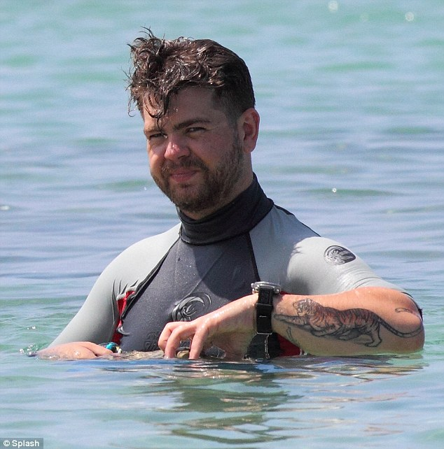 Hero: Newlywed Jack Osbourne saved a woman from drowning on the beach after she had a heart attack in Hawaii on Tuesday