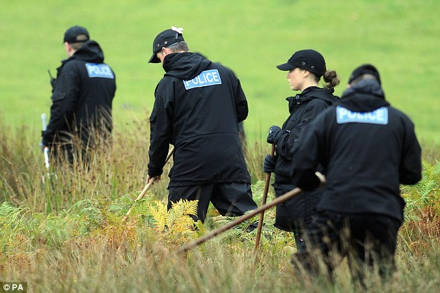 Hunting: A police team search land near Machynlleth, Mid Wales, for missing five-year-old April Jones