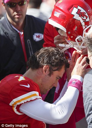 Examined: Cassel is looked after by Chiefs doctors after taking the brutal hit from Baltimore Ravens defensive tackle Haloti Ngata