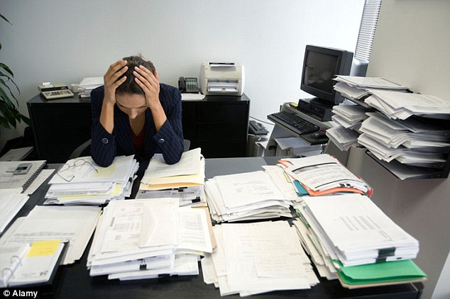 Headache: A third of bosses have seen an increase in the number of workers 'who struggle into work when unwell' over the last year (file picture)