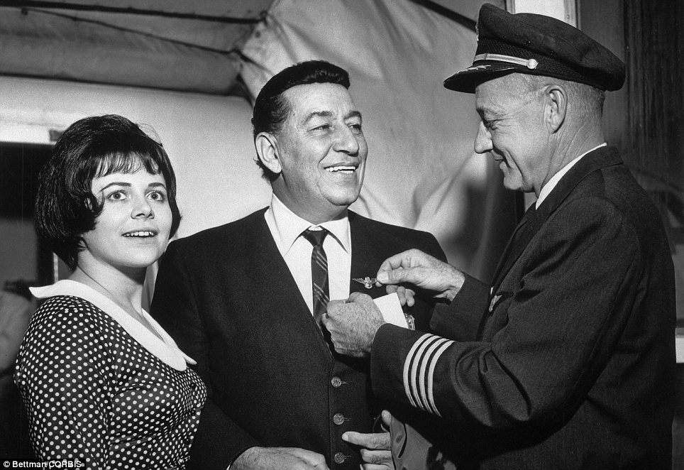 Stars: Air travel was once considered an exciting experience, as shown by this photograph of crooner Louis Prima about to board a flight at the terminal