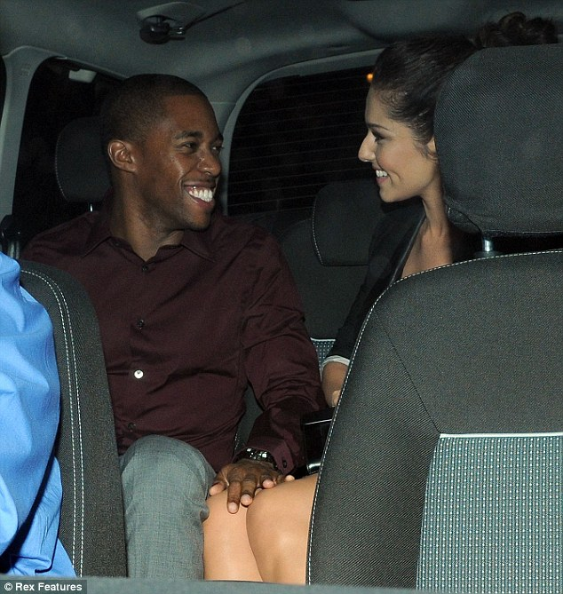 Love is in the air: The pair couldn't stop gazing at one another as they sat in the back of their waiting car