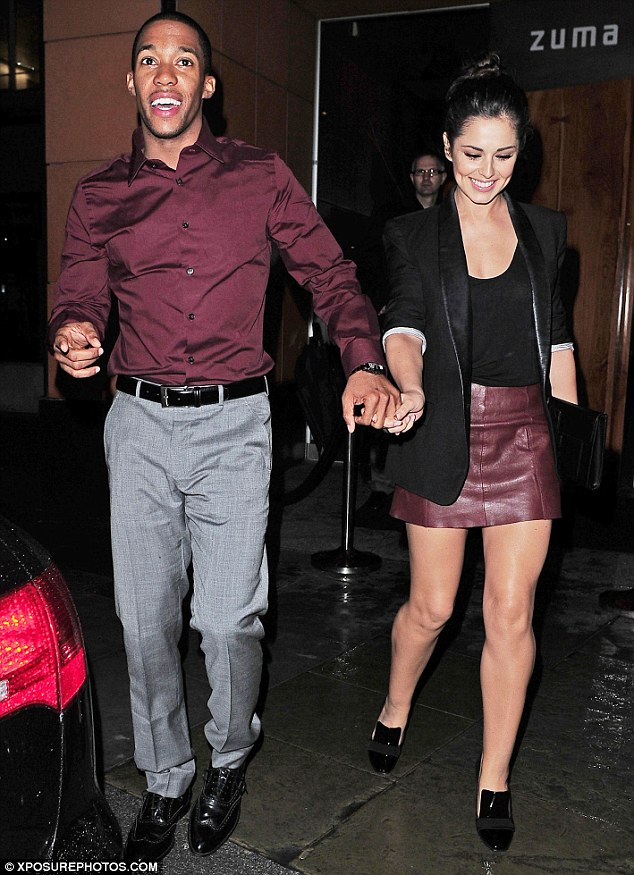 Matching pair: Cheryl Cole and her boyfriend Tre Holloway enjoy a night out together both wearing burgundy