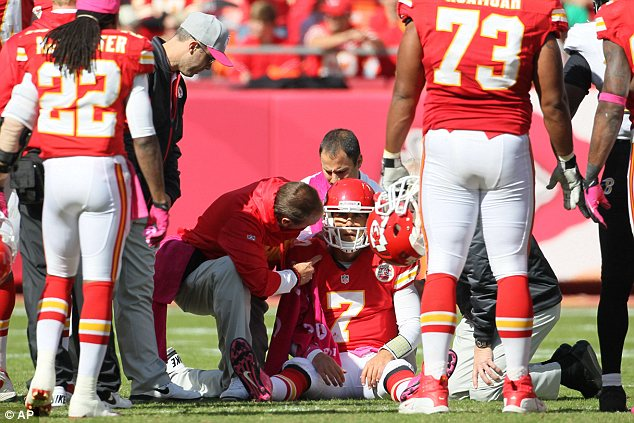 Brutality: Kansas City Chiefs quarterback Matt Cassel is surrounded by trainers and teammates after he suffered a head injury against the Baltimore Ravens on Sunday