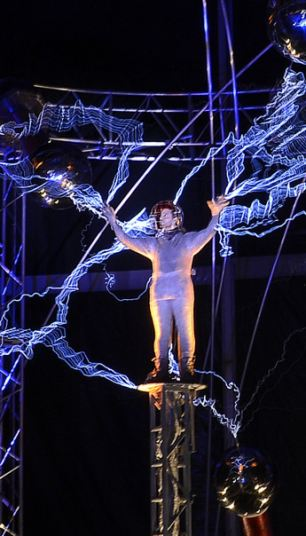 His most electrifying stunt: Magician David Blaine emerged weary but unharmed last night, left, after spending three days having volts of electricity pumped around his body, right