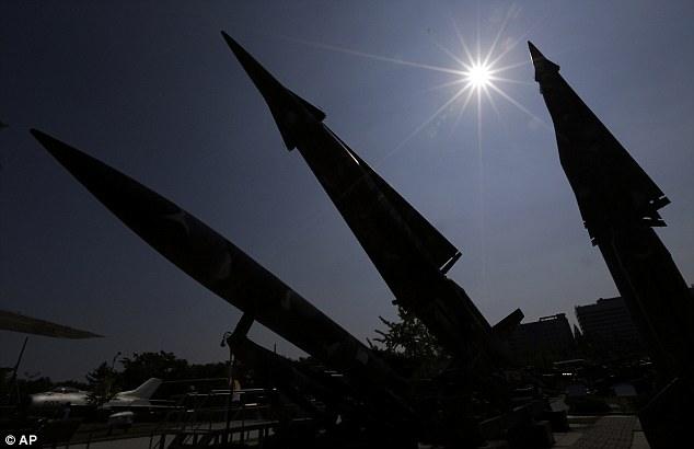 Deal: South Korean mock missiles are silhouetted at the Korea War Memorial Museum in Seoul, South Korea, as the country reveals the U.S. has agreed to allow it to develop longer-range missiles that could strike all of North Korea