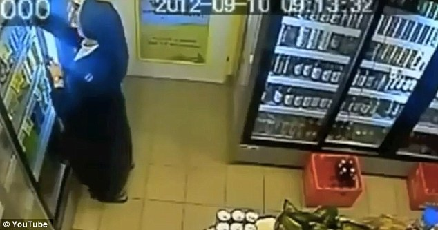 Oblivious: The thief seems unaware that a security camera is trained on her every move