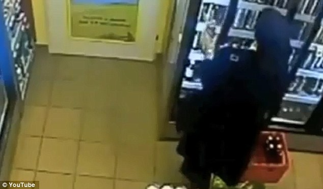 Oops, I did it again: The nun goes back for another beer before hightailing it out of the store