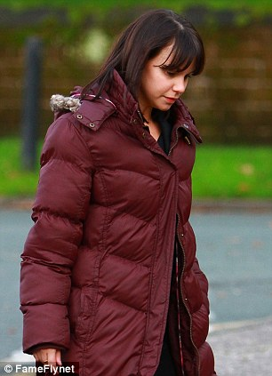 Keeping warm: Jessica Fox who plays Nancy Osborne in the soap wraps up in a padded coat and Ugg boots in between scenes