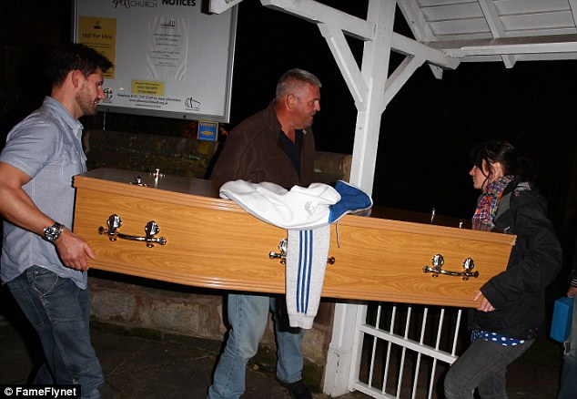 Pallbearers: Lynsey Nolan's coffin is carried through to the church ready for the funeral scenes