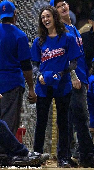 Batter up: Emily Rossum larks around on the set on the US version of Shameless on Friday