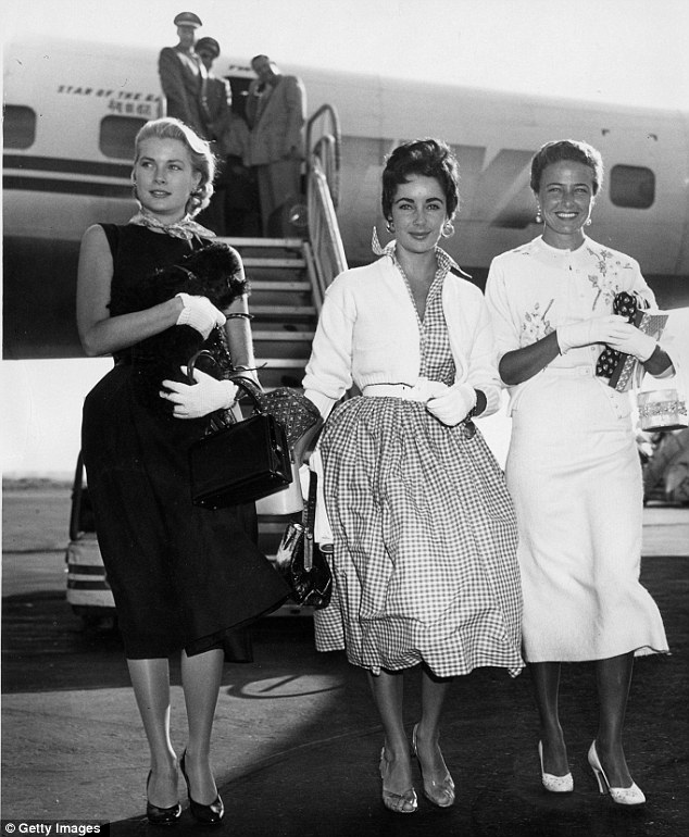 Hollywood stars: (L-R) Grace Kelly arrives in New York with fellow actresses Elizabeth Taylor and Lorraine Day, circa 1955